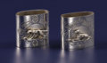 Silver Holloware, American:Napkin Rings, A Pair of American Silver Figural Napkin Rings. Unknown maker,American. Circa 1860-1880. Silver. Unmarked. 1.5 inches hig...(Total: 2 )