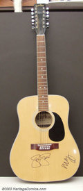 Music Memorabilia:Instruments, Neil Young and Steven Stills - Autographed Guitar A beautiful maplefinish acoustic guitar, signed boldly on the instrument'...