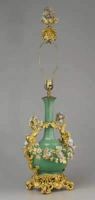 GREEN GLASS TABLE LAMP  Large green glass table lamp and shade, with floral gilt bronze and porcelain mounts and decorat...