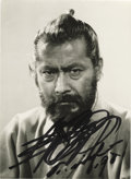"Movie/TV Memorabilia:Autographs and Signed Items, Toshiro Mifune Signed Photo. A wonderful 4.75"" x 6.5"" b&w photoof ""the Japanese John Wayne"" in period garb, signed boldly i..."