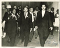 """Autographs:Celebrities, Martin Luther King Jr. Photo Signed, circa 1965. 10"""" x 8"""" B&Wphoto of a determined King on the move with various associates..."""