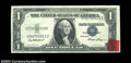 Error Notes:Shifted Third Printing, Fr. 1614 $1 1935E Silver Certificate. About Uncirculated. ...