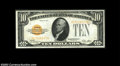 Small Size:Gold Certificates, Fr. 2400 $10 1928 Gold Certificate. About Uncirculated.
