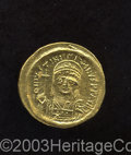 Ancients:Byzantine, Ancients: Justinian I. A.D. 527-565. AV solidus (21 mm, 4.44 g).Constantinople, A.D. 545-565. Diademed, helmeted and cuirassed bustf...
