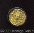Ancients:Byzantine, Ancients: Justin II. A.D. 565-578. AV solidus (19 mm, 4.50 g). Constantinople. Diademed, helmeted and cuirassed bust facing, holding V...