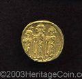 Ancients:Byzantine, Ancients: Heraclius. A.D. 610-641. AV solidus (20 mm, 4.44 g).Constantinople, A.D. 635/6(?). Heraclius in the center flanked byHerac...