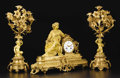 Bronze:European, A Gilt Bronze Mantle Clock Together with a Pair of Gilt Bronze FourLight Candelabra. Unknown maker, France. Late Nineteen... (Total: 3)