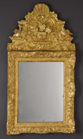 Furniture , A Continental Baroque Giltwood Mirror . Unknown maker, possibly Dutch or English. Circa 1700. Gilt on oak carcass. Unmarke...