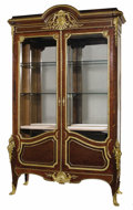 Furniture: French, A Monumental French Rococo-style Marquetry and Gilt Bronze VitrineCabinet. Francois Linke, Paris, France. Circa 1900. Sat...