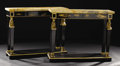 Furniture : Continental, A Pair of Empire-style Ebonized Console Tables. Unknown maker,Continental. Twentieth century. Ebonized and gilt wood, mar...(Total: 2 )