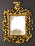 Furniture : Continental, An Italian Baroque-style Carved and Giltwood Mirror. Unknown maker,Venice, Italy. Nineteenth century. Carved and gilded w...