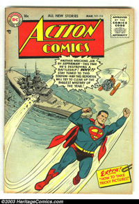 Action Comics #214 (DC, 1956) Condition: VG+. Fantastic Superman cover. Cover is detached from bottom staple, otherwise...