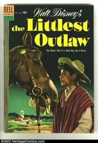 Four Color #609 The Littlest Outlaw (Dell, 1954) Condition: VF. Classic photo cover. Overstreet 2003 VF 8.0 value = $53...