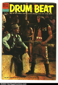 Four Color #610 Drum Beat (Movie) (Dell, 1955) Condition: VF/NM. Charles Bronson and Alan Ladd photo cover on this class...