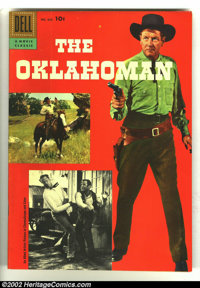 Four Color #820 The Oklahoman (Movie) (Dell, 1957) Condition: VF/NM. Cool photo cover Western. Overstreet 2003 VF/NM 9.0...