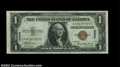 Small Size:World War II Emergency Notes, Fr. 2300 $1 1935 Hawaii Silver Certificate. Three ... (3 notes)