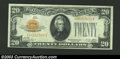 Small Size:Gold Certificates, 1928 $20 Gold Certificate, Fr-2402, XF+. There are a couple ...