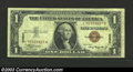 Small Size:World War II Emergency Notes, 1935-A $1 Hawaii Silver Certificate, Fr-2300*, VF. This is a ...