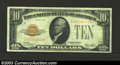 Small Size:Gold Certificates, 1928 $10 Gold Certificate, Fr-2400, VF-XF. This gold note is ...