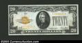 Small Size:Gold Certificates, 1928 $20 Gold Certificate, Fr-2402, VF-XF. This is a very ...