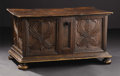 Furniture : Continental, Carved Italian Cassoni. Unknown maker, Italian. Seventeenthcentury. Walnut. Unmarked. 18.5 inches high x 35 inches wide x...