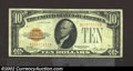Small Size:Gold Certificates, 1928 $10 Gold Certificate, Fr-2400, VF-XF. This is a lovely ...
