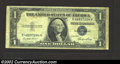 Error Notes:Skewed Reverse Printing, 1935E $1 Silver Certificate, Fr-1614, Very Fine. The back is ...