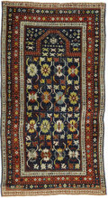 Rugs & Textiles:Carpets, An Antique Daghestan Prayer Rug. Caucasian, Circa 1870. Wool. 64.5inches x 38.2 inches. Beautiful blue background with ...