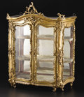 Furniture: French, A French Louis XV Miniature Giltwood Vitrine Cabinet. Unknownmaker, French. Eighteenth century. Carved and gilded wood, g...