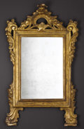 Furniture : Continental, A Continental Giltwood Mirror. Unknown maker, Italian. NineteenthCentury. Carved and gilded wood, mirrored glass. Unmarke...