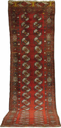 Rugs & Textiles:Carpets, A Bokahara Runner. Uzbek, Circa 1940. Wool. 40 inches x 173 inches.Woven with brown medallions on wine red field....