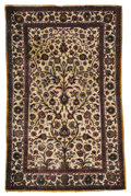 Rugs & Textiles:Carpets, A Souf Kashan Rug. Central Persia. Circa 1910. Silk, wool. 81.5inches x 52.75 inches. Woven with embossed silk floral m...