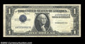 Error Notes:Inverted Third Printings, Fr. 1613 $1 1935D Silver Certificate. Very Fine+. An ...