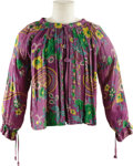 Music Memorabilia:Costumes, Jimi Hendrix Owned Floral Shirt. A purple floral shirt, owned and worn by Jimi Hendrix, with drawstring cuffs and scoop neck... (Total: 1 Item)