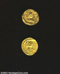 Ancients:Roman, Ancients: Byzantine GOLD tremissis lot, A 2-coin lot includingAnastasius/Victory grading EF with wavy flan and Heraclius/Crossgradin... (Total: 2 coins Item)