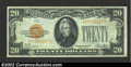 Small Size:Gold Certificates, 1928 $20 Gold Certificate, Fr-2402, XF. This is a very bright ...