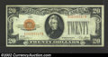Small Size:Gold Certificates, 1928 $20 Gold Certificate, Fr-2402, VF-XF. This well margined ...