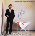 Autographs, Eric Clapton Signed Money and Cigarette Album