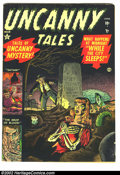Golden Age (1938-1955):Horror, Uncanny Tales #1 (Atlas, 1952) Condition = VG. Water stain throughlower right hand corner of book....