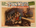 "Movie Posters:Animated, Snow White and the Seven Dwarfs (RKO, 1937). Lobby Card (11"" X14""). In one of the films lighter moments, Dopey runs down th..."
