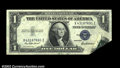 Error Notes:Foldovers, Fr. 1615 $1 1935F Silver Certificate. Extremely Fine. An ...