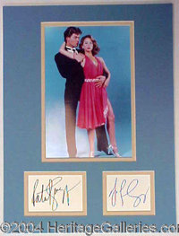 Dirty Dancing--Swayze and Grey - Superb 12 x 16 custom double matted display, featuring the signatures of Patrick Swayze...