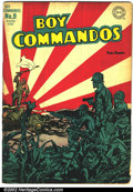 Golden Age (1938-1955):War, DC War Lot (DC, 1944 and 1953). This lot consists of two DC warcomics. Boy Commandos #9 features the classic Japanese risin...