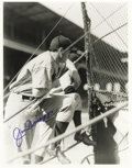 Baseball Collectibles:Photos, Joe DiMaggio Signed Large Photograph by Brace. The owner of baseball's sweetest swing advises his teammates in this fine im...