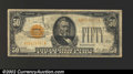 Small Size:Gold Certificates, 1928 $50 Gold Certificate, Fr-2404, Fine. This note has a ...
