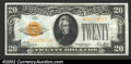 Small Size:Gold Certificates, 1928 $20 Gold Certificate, Fr-2402, AU. At first glance this no...