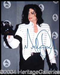 Michael Jackson - Excellent 8 x 10 color photo featuring Jackson holding one of his many Grammy Awards which he has won...