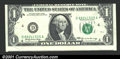 Error Notes:Skewed Reverse Printing, 1969 $1 Federal Reserve Note, Fr-1903-D, XF. The obverse is ask...