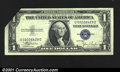Error Notes:Attached Tabs, Fr. 1612 $1 1935C Silver Certificate. Gem Crisp Uncirculated....