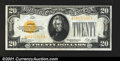 Small Size:Gold Certificates, Fr. 2402 $20 1928 Gold Certificate. About Uncirculated.Ju...